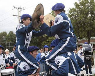.          ROBERT  K. YOSAY | THE VINDICATOR..Yep Battle of the drum sections as Poland Students play the cymbals hoisted on bandmembers shoulders..Boardman Spartans at Poland Bulldogs Stadium