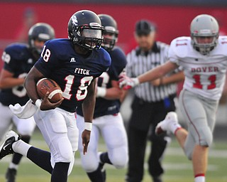 Fitch quarterback #18 Antwan Harris breaks away from the pack to score the first Fitch touchdown on the night on a 4th and 1 play in the 1st quarter. Dover #11 Alex Bowman pictured.