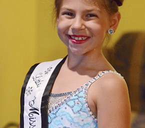 Isabella Rexroad, 7, is the Little Miss Majorette of America. She said shes likes being able to perform big tricks and trying her best.  Photo by Nick Mays | The Vindicator