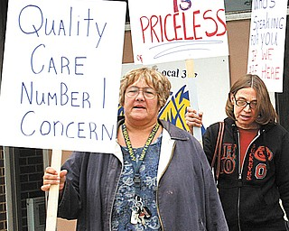 ValleyCare Northside Medical Center registered nurses, holding signs for today's one-day strike at the hospital on Gypsy Lane on Youngstown's North Side, stand in front of Teamsters Local 377 hall Monday, where they received a final briefing on their strike duties.