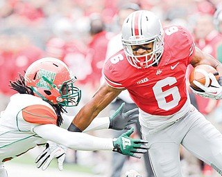 Ohio State wide receiver Evan Spencer (6) tries to escape the grasp of Florida A&M cornerback Patrick Aiken during the first quarter of a game in Columbus. The Buckeyes open Big Ten play Saturday when they take on Wisconsin.
