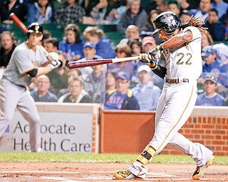 Pittsburgh Pirates' Andrew McCutchen hits a single off Chicago Cubs starting pitcher Jeff Samardzija during the  first inning of a game Monday in Chicago.