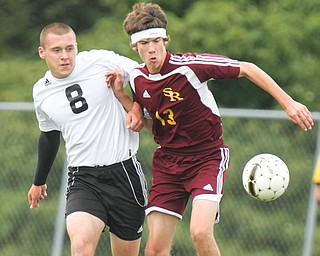 Crestview's Greg Bable (8) and South Range's Jonah Wilson (13) battle for control of the ball during a match on Monday.