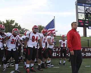 Youngstown State head coach Eric Wolford (right) leads the Penguins onto the field before the start of Saturdays matchup against Southern Illinois University in Carbondale Illinois.  Dustin Livesay     The Vindicator  9/28/13  Carbondale Illinois.