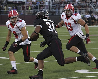 Southern Illinois running back Malcolm Agnew (31) attempts to rush the ball but is tackles for a loss by Donald D'Alesio (8) and Kyle Sirl (33) during the first quarter of Saturday's matchup at Southern Illinois University in Carbondale Illinois.  Dustin Livesay     The Vindicator  9/28/13  Carbondale Illinois.