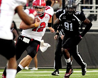 Youngstown State's Kurt Hess runs the ball in front of Southern Illinois' Kitray Solomon during the first half of the teams game at Saluki Stadium on Saturday, Sept. 28, 2013, in Carbondale, Ill. (Paul Newton / The Southern)