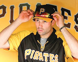 Pittsburgh Pirates Neil Walker adjusts his sunglasses in the dugout during the team's workout in Pittsburgh Monday. The Pirates face the Cincinnati Reds in the National League wild card game today in Pittsburgh.
