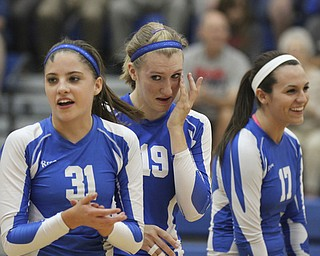 William D Lewis The Vindicator Jax Milton Erica Hughes(19) reacts after scoring her 1,500 career kill during Wed 1--02-13 game with Western Reserve. she is flankedby teamatesTaylor Tharp(31) and Madison Tomaino(17).