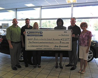 SPECIAL TO THE VINDICATOR Greenwood Chevrolet of Austintown's 18th annual employee golf outing took place earlier this summer at Bedford Trails Golf Course. Proceeds of $2,175 from the event were given to the Boys & Girls Club of Youngstown. Above, from left, are Greg Faunda and Jim Timko, Greenwood employees; Rachel Kerns, development director of Boys & Girls Club; Ruthie King, executive director of Boys & Girls Club; Greg Greenwood, owner of Greenwood Chevrolet; and Gwen Fabian, Greenwood employee.