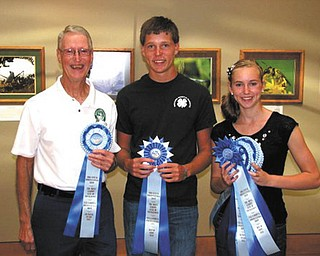 SPECIAL TO THE VINDICATOR The Men's Garden Club of Youngstown horticulture show took place Aug. 25 with 22 youth entries and 215 adult entries. From left are Rodney Toth, adult sweepstakes winner; Robert Voland, best of show; and Tiffany Voland, best of show and youth sweepstakes winner.