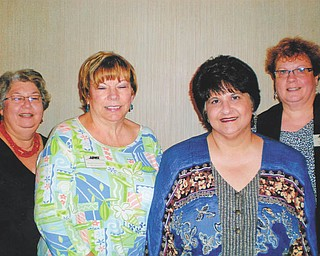 SPECIAL TO THE VINDICATOR Mill Creek Chapter of the American Business Women's Association installed officers at a recent meeting at Beard Cabin in Boardman Park. From left are Kathy Anderson, treasurer; Marilyn Abramski, secretary; Bonnie Pannunzio, vice president; and Mary Brown, president. Officers will preside until July 2014. The president will represent the club at the National Convention in Little Rock, Ark., this fall.