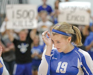 Erica Hughes of Jackson-Milton wipes her eyes after recording her 1,500th career volleyball kill during a home game against Western Reserve. The Bluejays fell to the Blue Devils, 3-0