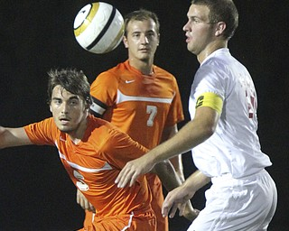 William d Lewis the Vindicator  Howland's  Benji rush(5) and Canfield's Brady Clark(16) battle for the ball. In background is Howland'sTyler Spain (7)