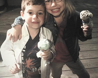 Grandchildren Evan and Hannah Straub are all smiles while enjoying ice cream on the boardwalk in Kennebunkport, Maine. Sent by Chuck Straub of Salem.