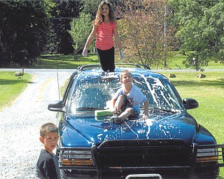 Trystin Nelson, 8, Xavier Nelson, 4, and Chase Nelson, 6, are washing Mom's car. Sent by Kathy Mackall of Columbiana.