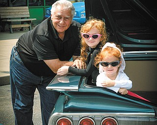Lauren and Claire O'Leary of Youngstown perch in Papa Butch's 60 Chevy with proud Papa, Bob Chicone of McDonald, supervising.