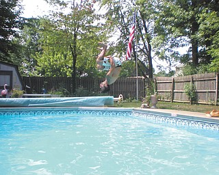 Joe Zordich of the West side of Youngstown, flips into the pool. Photo by his mother, Laura Brown.