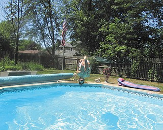 A front view as Joe Zordich does a flip into the pool, taken by his mother, Laura Brown.