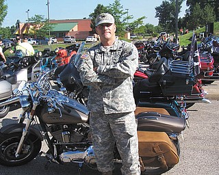Sgt Gunn, of Meadville, Pa., now serving in San Diego, Calif., escorted the Vietnam Moving Wall from Warren, Ohio to Hermitage, Pa. in August 2012. It was not an assignment, he volunteered to join more than 800 motorcycles. Sent by Kelly L. Morocco.