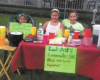At the end of the summer Lilly Donatelli, Sarah Kinderdine and Madalyn Smith offer beverages and popcorn to help beat the heat. They are friends from West Blvd. School in Boardman. Sent in by Madalyn's Nana Patty Hoover.