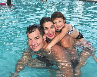 Brenda Fusek sent this picture of her son, Michael Fusek III,  her daughter-in-law, Laura, and her granddaughter, Taylor Elizabeth, 3 1/2, while they are basking in the cool water while vacationing in Fort Lauderdale, Fla.