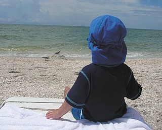 Nico Gentile of Salem, catching some rays while watching the birds in Naples, Fla. Sent by Nick and Andrea Gentile.