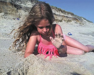 Lilyanah Miller enjoyed the sand on the beach at Nantucket Island with her mom, Erica McElroy, and her dad, Adam Miller.