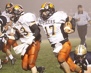 .          ROBERT  K. YOSAY | THE VINDICATOR..Wellsville #17 Jordan Sloan follows #23 Zack Mellot as he rambles into the TD at Lowellville