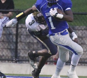 William d Lewis The Vindicator  Hubbard' s Darnell Tate(1) eludes Brookfield's Jamar Tarver(3).