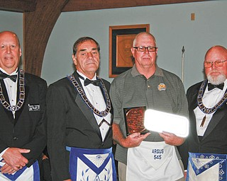 SPECIAL TO THE VINDICATOR:  Participating in the recent honors ceremony of Argus Lodge 545 of Canfield and presenting the Mason of the Year award are, from left, Denny Furman, master of ceremonies; Russell W. Gillam; Ted P. Underhill, recipient; and Dale E. Hawkins, narrator.