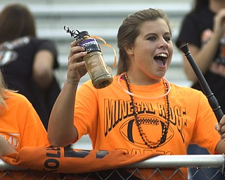 Kelli Cardinal/The Vindicator .Darby Kolesar, a junior at Mineral Ridge, cheers for the Rams at their game Friday against McDonald at Whittaker Field.