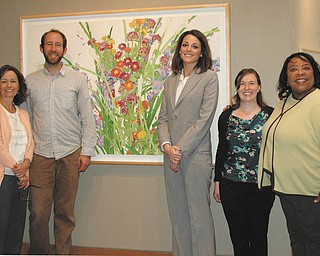"SPECIAL TO THE VINDICATOR: Committee members of the ""Watercolors at the Gardens — An Evening with Gary Bukovnik"" event are, from left, Janey Donadee, co-chair; Adam Lee of The Sprouted Table; Katie Ann Heddaeus; Mandy Smith and Madonna Pinkard. They are standing in front of Bukovnik's watercolor ""Joy."""