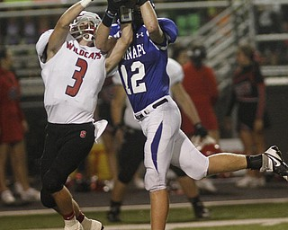 .          ROBERT  K. YOSAY | THE VINDICATOR..Interception as Polands #12 Tyler Smith takes the pass away from Struthers  #3 Dalton Moore .during second quarter action..Poland  vs Struthers @ Poland