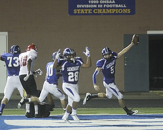 .          ROBERT  K. YOSAY | THE VINDICATOR..Polands #5 Jacob Wolfe -qb on the keeper celebrates  as he goes 61 yards for a TD with him is polands #28 Marion Ramirez ..Poland  vs Struthers @ Poland