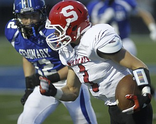 .          ROBERT  K. YOSAY | THE VINDICATOR..Poland #12  Tyler Smith hones in on Struthers #3 Dalton Moore after Dalton picked up a first down in the first quarter...Poland  vs Struthers @ Poland