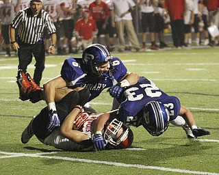.          ROBERT  K. YOSAY | THE VINDICATOR..#23   Adam Wollet and#6  Geno Petrus  catches #3 Struthers Dalton Moore for a big loss as they had driven to the 4 yard line but were stopped by the poland defense..Poland  vs Struthers @ Poland