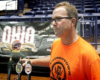 MADELYN P. HASTINGS | THE VINDICATOR..Tom Smith talks with a customer about the Ohio Brewing Company out of Akron during the Beer Fest at the Covelli Center on Saturday, October 5, 2013. ... - -30-..