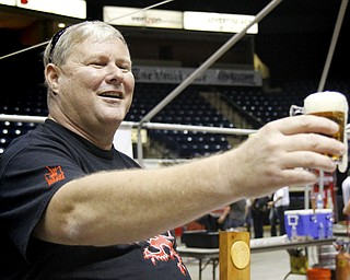 MADELYN P. HASTINGS | THE VINDICATOR..Tim Beauchamp of Boardman pours a Kentucky Bourbon Barrel Ale for a customer at the Beer Fest at the Covelli Center on Saturday, October 5, 2013. ... - -30-..