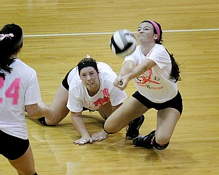 MADELYN P. HASTINGS | THE VINDICATOR..(L-R) Boardman's Faith Saunders (18) and Krista Johnson (13) fall for the ball during their game against Fitch at Boardman High School on Saturday, October 5, 2013. Boardman went on to win three consecutive games. .... - -30-..