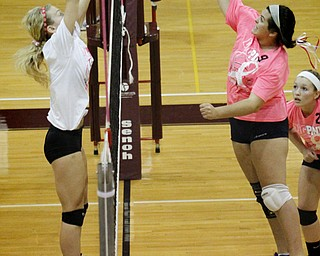 MADELYN P. HASTINGS | THE VINDICATOR..(L-R) Boardman's Amanda Lipke (17) blocks a spike by Fitch's Maura Bianco (9) during their game at Boardman High School on Saturday, October 5, 2013. Boardman won three consecutive games. ... - -30-..