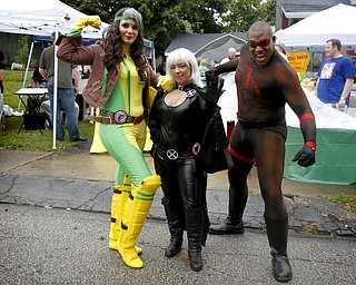 MADELYN P. HASTINGS | THE VINDICATOR..(L-R) Riley Rivera of Cleveland, Stephanie Karasevich of Cleveland, and Michael Knightmage of Youngstown,  pose for a portrait dressed as X-Men's Storm, X-Men's Rouge and the Daredevil respectively at the fourth annual Lawn-Con on the west side on Saturday, October 5, 2013. ... - -30-..