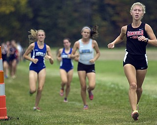 Kelli Cardinal/The Vindicator .Raquel Markulin, a freshman from Canfield, stays ahead of the pack Saturday in the girls Division I race during the Legends Cross Country Meet at Trumbull County Fairgrounds.
