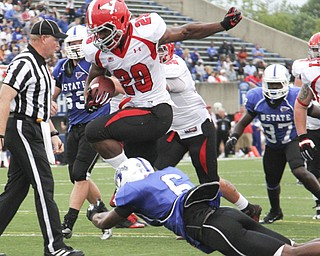 Youngstown State's Martin Ruiz (29) leaps over Indiana State's Othniel Harvey (6) on his way to scoring his second touchdown of the night during the second quarter of  Saturday nights matchup at Indiana State University in Terre Haute, Indiana.  Dustin Livesay  |  The Vindicator  10/05/13  Indiana State University.