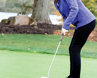 Poland senior Melinda Hannon practices her putting during Monday's practice at the Lake Club. Hannon will compete in the Division II state golf meet this weekend in Columbus.