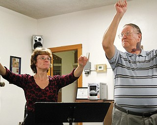 Jim Antell, choir director at Girard First United Methodist Church, and his daughter, April Antell Tarantine, who directs the choir in her father's absence, take the choir through a recent rehearsal. Antell has served 50 years as choir director at the church.
