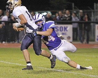 .          ROBERT  K. YOSAY | THE VINDICATOR..Lowellville #16  Alex Harklerode is brought down for a loss by WR  #44Dan Zilke  during third quarter action Lowellville at Western Reserver