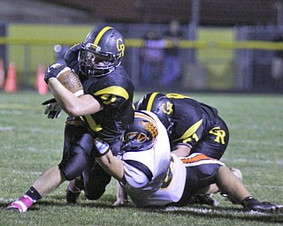 Crestview's Jake Ferris (41) stretches for a few extra yards before being brought down by Springfield's Mark Schuler (86) during the first quarter of Friday nights matchup at Crestview High School.  Dustin Livesay  |  The Vindicator  10/11/13 Crestview High School.