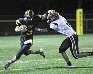 Quarterback Colin Gilbert (9) of Crestview stiff arms Mike Allgower (6) of Springfield during the second quarter of Friday nights matchup at Crestview High School.  Dustin Livesay  |  The Vindicator  10/11/13 Crestview High School.