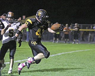 Crestview senior Jake Ferris (41) reaches the ball over the goal line after breaking through the Springfield defense in the closing minute of the first half during Friday nights matchup at Crestview High School in Columbiana.  Dustin Livesay  |  The Vindicator  10/11/13  Crestview High School.
