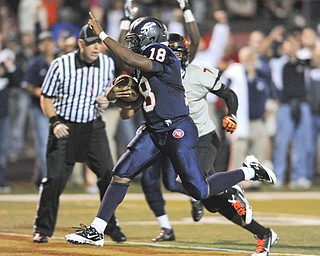 Fitch #18 Antwan Harris sprints into the the end zone to score a touchdown after getting past Massillon #7 Reggie Rogers.